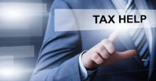 Pantalla táctil con la frase Tax help
